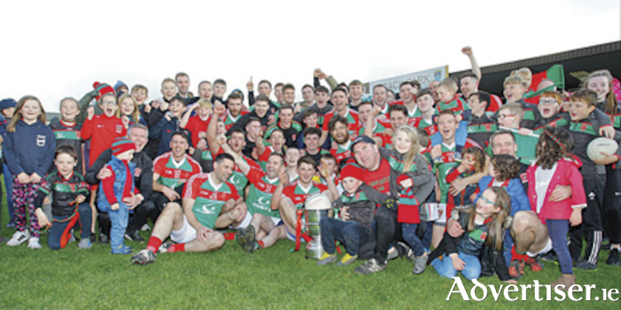 The Garrycastle senior football playing squad celebrate with their legion of supporters following their four point final victory over St. Lomans in the county final on Sunday.  Photograph by AC Sports Images.