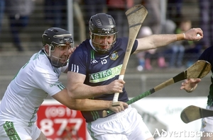 Laim Mellows' Aonghus Callanan comes under pressure from Sarsfields' Darren Skehill in action from the Salthill Hotel Galway Senior Hurling quarter-final at Kenny Park on Sunday.  						Photo:-Mike Shaughnessy