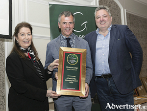 Wineport Lodge proprietor, Ray Byrne, accepts the 'A Taste of the Waterways' award.  Pictured, l-r, Georgina Campbell, Ray Byrne and Richard Corrigan.
