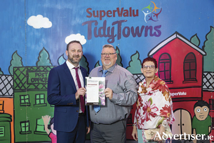 Jimmy Redmond (centre), recieves his Super Valu Community Hero award at the Tidy Towns ceremony held in The Helix recently.  He is pictured with Eoin Kennedy and Geraldine Redmond