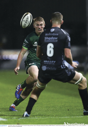 Connacht's Conor Fitzgerald produces a clever chip past Huw Taylor of Dragons during the Guinness PRO14 match at Rodney Parade in Newport, Wales. Photo by Gareth Everett/Sportsfile