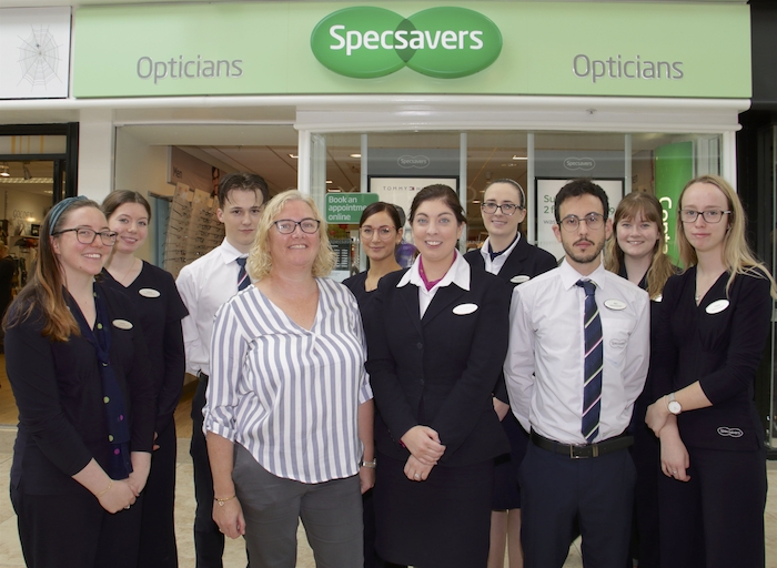 Annette Flanagan and Maeve O'Sullivan with their team at Specsavers Galway Shopping Centre. Photo:-Mike Shaughnessy