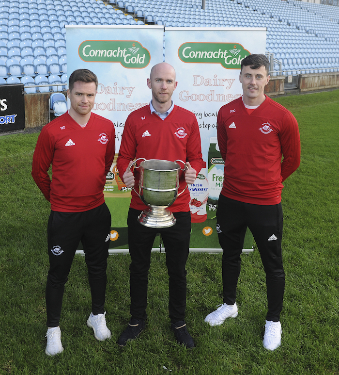 The boys from the 'Tubber: Ballintubber's Damien Coleman, Kevin Johnson and Diarmuid O'Connor with the Moclair Cup ahead of the Connacht Gold Mayo GAA Senior Football Final. Photo: Conor McKeown.
