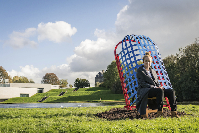 Artist Niamh McCann with her striking new sculptural work at the National Museum of Ireland - Country Life, Turlough, Co. Mayo. The lakeside installation reflects themes of craft-making, past, present and belonging. Photo: Keith Heneghan