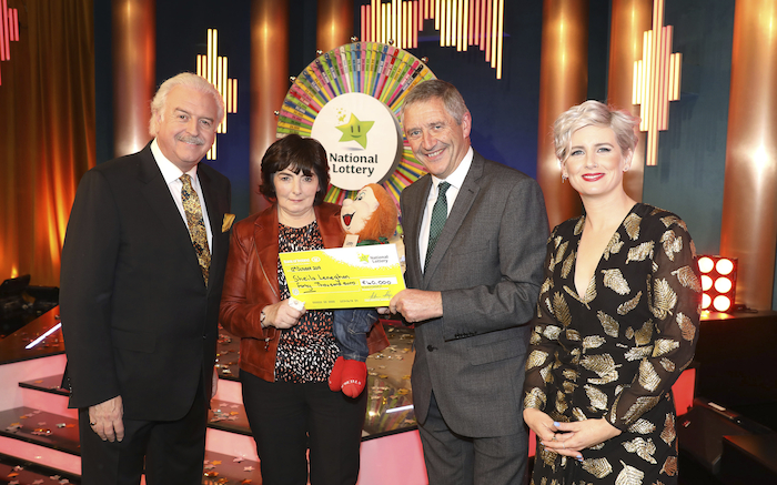 Sheila Leneghan from Castlebar, Co. Mayo has won €40,000 including a holiday to Madeira on last Saturday's Winning Streak Game Show on RTE. Pictured here at the presentation of the winners cheques were from left to right: Marty Whelan (Winning Streak game show co-host); Sheila Leneghan the winning player; Declan Murray (National Lottery) and Sinead Kennedy (Winning Streak Game Show co-host). The winning ticket was bought from The Harbour Store, The Quay, Westport, Co. Mayo. Photo: Mac Innes Photography