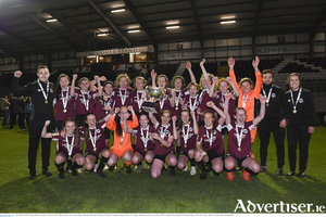 Kayla Brady, captain of Galway WFC, lifts the cup as her teammates celebrate after winning the So Hotels Women's National League U17 League final by 3-1 against  Wexford Youths at Eamonn Deacy Park in Galway. Photo by Matt Browne/Sportsfile