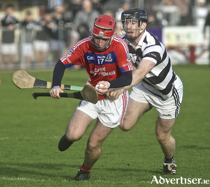 Turloughmore's Michael Morris attempts to stop Damien McGlynn of StThomas in action from the Senior Hurling Championship at Athenry semi-final at Kenny Park on Sunday. Photo:- Mike Shaughnessy