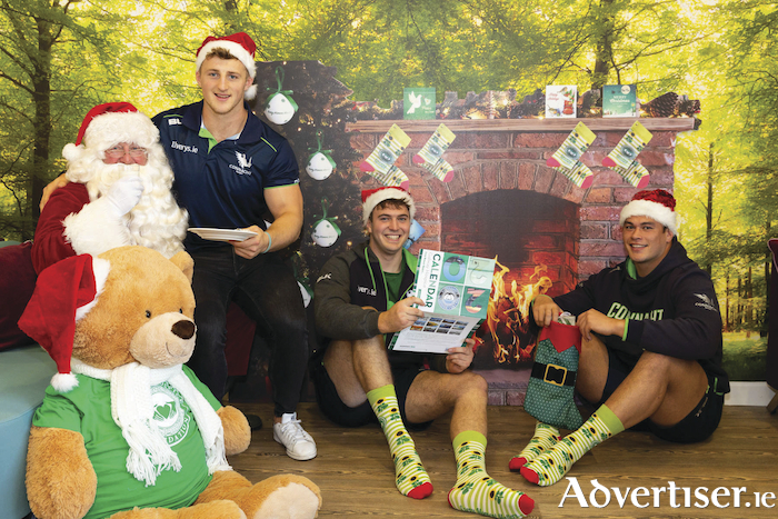 Connacht Rugby players Peter Robb, Joe Maksymiw and Dominic Robertson-McCoy join Santa Claus at the launch of the Galway Hospice Christmas Campaign. Photo: Martina Regan.