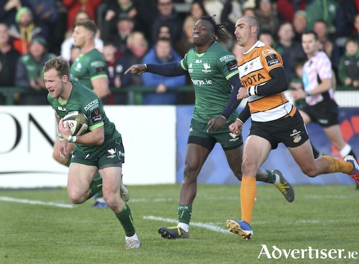 Over he goes: Kieran Marmion about to score Connacht's second try watched by Niyi Adeolokun and Ruan Pienaar of Toyota Cheetahs  in action from the Guinness PRO14 game at the Sportsground on Saturday. Photo: Mike Shaughnessy