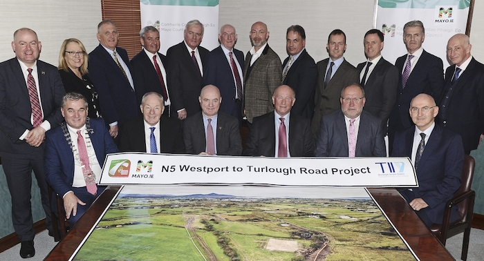 At the signing of the contracts for the N5 Westport to Turlough Road project were: Front row:  Cllr Brendan Mulroy (Cathaoirleach of Mayo County Council), Minister Michael Ring TD, Peter Hynes (Chief Executive, Mayo County Council) Charles Wills, (Wills Brothers Limited), Tadhg Lucey (BAM Ireland), Michael Nolan, (Transport Infrastructure Ireland) together with representatives from Mayo County Council, Wills Bam Joint Venture, Transport Infrastructure Ireland  and Roughan and O'Donovan