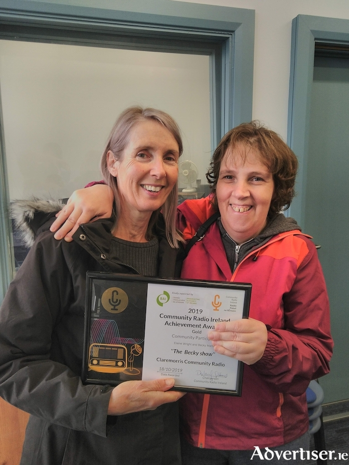 Elaine Wright (left) and Becky Martin (right) receive their award at Claremorris Community Radio's new studios at Chapel Court, Chapel Lane, Claremorris