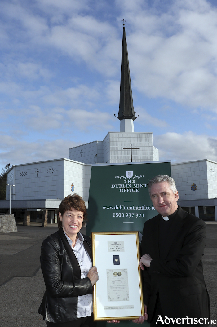 Kathy Clarke, Country Manager for The Dublin Mint Office, and Father Richard Gibbons, Parish Priest for Knock at the presentation of a medal celebrating the 40th anniversary of the visit of Pope John Paul II to Ireland. The Dublin Mint Office donated a medal to Knock Shrine this week. Photo: Keith Heneghan.