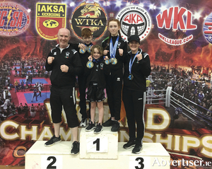 Fighting fit family: The Foley family of Annaghdown who won medals at the Unified World Champions in Italy - father and coach Pete Foley of Black Dragon Kickboxing Club, with Finn, Belle, Faith and mum Clodagh.