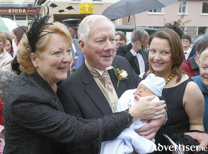 Gay Byrne and his wife Kathleen Watkins with their grandson, then six day-old Cian, and his mother Suzy, at the marriage of their daughter Crona and Philip Carney at Spiddal Church in 2004.  Photograph by Mike Shaughnessy.