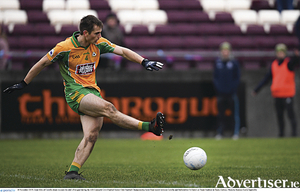 Liam Silke of Corofin shoots to his side's first goal in  the AIB Connacht GAA Football Senior Club Football Championship semi-final match between Corofin and Ballintubber St Enda's at Tuam Stadium in Tuam, Galway. 