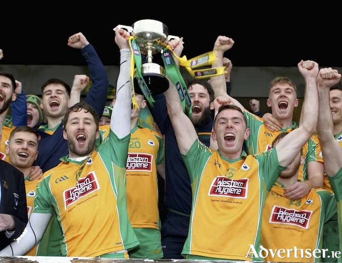 Corofin's Micheal Lundy and Jason Leonar with the Shane McGettigan Cup after winning the  Connacht Senior Club Football Championship final against Padraig Pearses at Tuam Stadium.