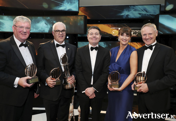Pictured at the EY Entrepreneur of the Year awards ceremony: Pat McDonagh, EY Industry Entrepreneur Of The Year;  Richard Kennedy, EY Entrepreneur Of The Year;  Minister Paschal Donohoe; Triona Mullane, EY Emerging Entrepreneur Of The Year;  Joe Schmidt, Special Award winner on stage.
