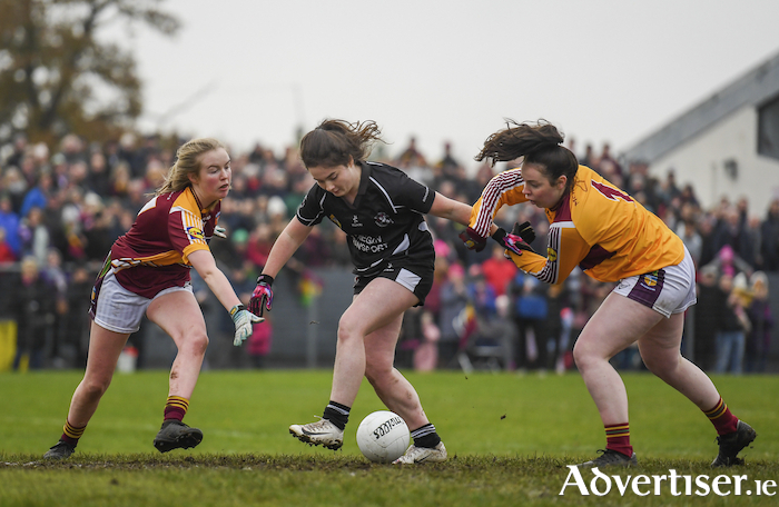 Eyes on the ball: Grace Murray and Niamh Larkin of MacHale Rovers try to stop Amy Walsh getting a shot off in last weekends All Ireland final. Photo: Sportsfile