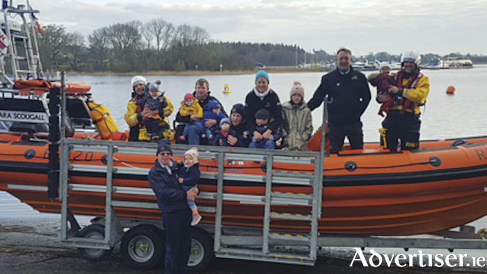 Some of the Lough Ree RNLI families who will be on call this Christmas. Pictured from left are helm, Emmet and daughter Isabelle Deveraux, helm, Tom Bradbury with twin sons Tom and Ben, helm, Stan and son Luke Bradbury, Lifeboat Press Officer, Sarah and son, Alex Bradbury, deputy launching authority, Jude and daughter Ella Kilmartin, crew member, Patrick and daughter Annie Walsh, while to the front is treasurer, Vincent and granddaughter, Ella Rafter.