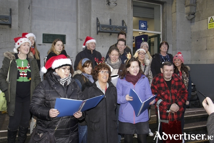 Members of the Galway Simon Choir entertaining customers of Bus Éireann at Ceannt Station, Galway on Thursday. Photo:-Mike Shaughnessy