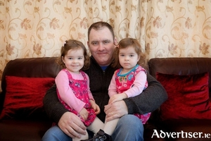 Mark Hayes with his daughters.