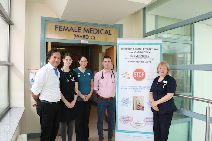 Dr Syed Rizvi, Consultant Physician; Dr Ciara Clarke; Grace Hallinan, Dietitian; Dr Eoin Keating and Emer Mulvihill, Clinical Nurse Manager at Mayo University Hospital with the hand hygiene poster at the entrance to all wards to remind staff, visitors and patients of the importance of hand hygiene.