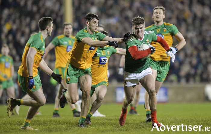 On the run: Jordan Flynn looks to break away from the Donegal defence on Saturday night. Photo: Sportsfile