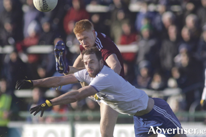 Galway corner forward Adrian Valley and Monaghan's Conor Boyle in action from the Allianz National Football League game in Pearse Stadium on Sunday.	Photo:-Mike Shaughnessy