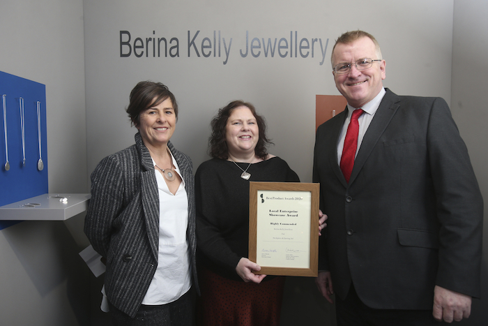 Berina Kelly receiving her award at Showcase in the RDS with DCCI's Managing Executive Louise Allen and Chair of the network of LEOs, Oisín Geoghegan. Image: Leon Farrell Photocall Ireland.