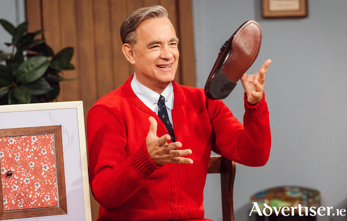 Tom Hanks as Fred Rodgers.