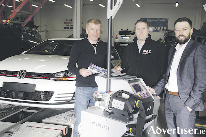 Frank Byrne, with Dave Mullane, service manager Monahan & Sons, and  Oisin Daly of Volkswagen Group's  body and paints business development, on the commissioning of Frank Bynes Autobody Repairs' new welding machine.