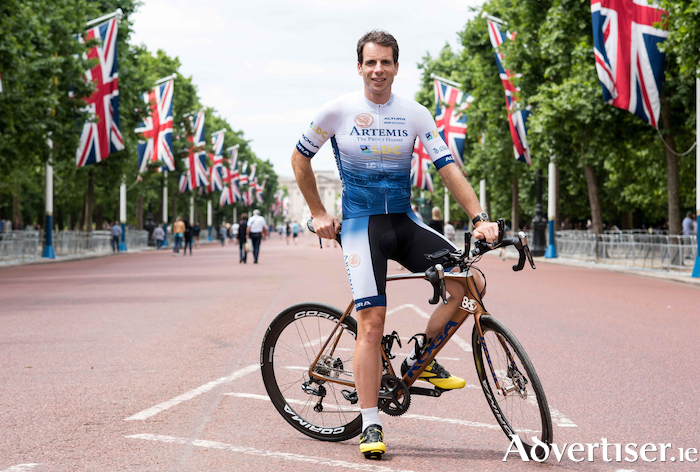 Mark Beaumont on the road to Buckingham Palace.
