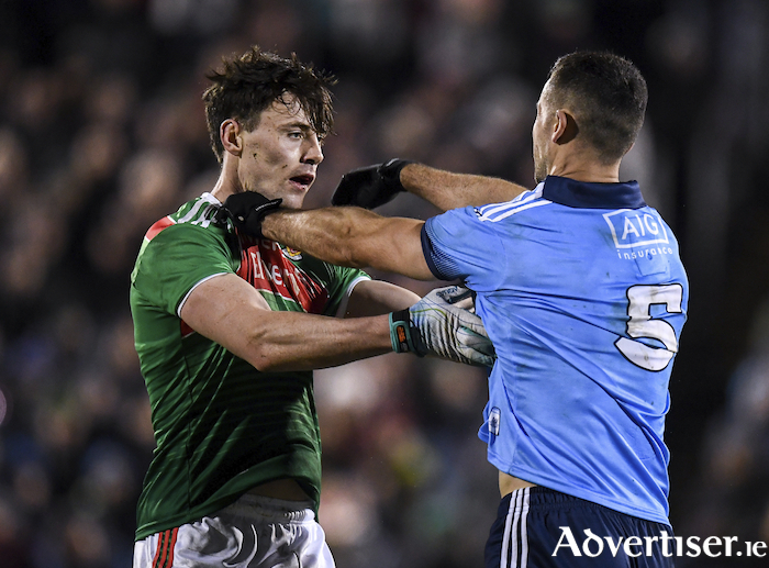Getting to know you: Diarmuid O'Connor and James McCarthy get to grips with each other last Saturday night. Photo: Sportsfile