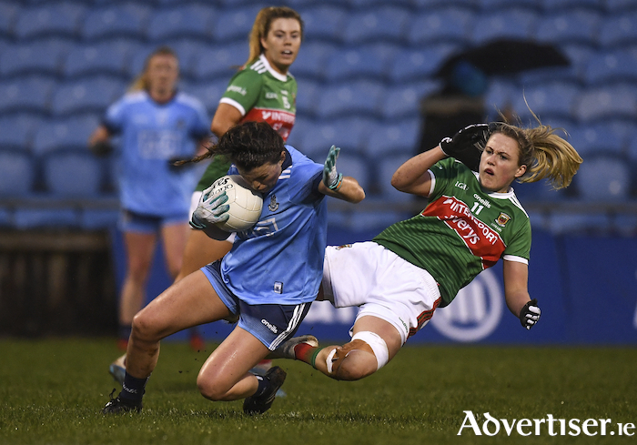 Rough and tumble: Fiona Doherty challenges Mayo's Leah Caffery in MacHale Park last Saturday night. Photo: Sportsfile.