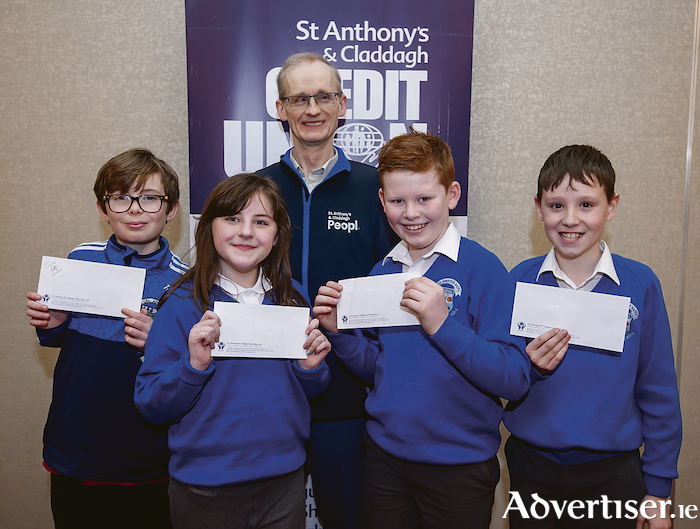 Tom Carroll, Kayleigh Faherty, Tadhg Cronin and Daniel O'Connor from St Annans National School Roscahill, junior runners up in  in the St Anthony's and Claddagh Credit Union School Quiz pictured with board member Aidan McDonagh at the quiz in the Salthill Hotel on Sunday. Photo: Reg Gordon