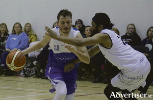 Maree's Orioles Balsells Plaza and DSB Eanna's Paris Ballinger  in action from the Basketlball Ireland Mens Super League game at Corrandulla Hall on Saturday. Photo:-Mike Shaughnessy