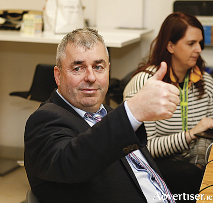 Outgoing Athlone Deputy, Kevin 'Boxer' Moran, acknowledges the media during the General Election Longford/Westmeath constituency count on Sunday night.  Photograph by Michaela Fox of Wild Heart Photography.