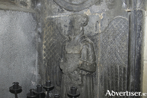 A damaged angel on the Lynch altar.