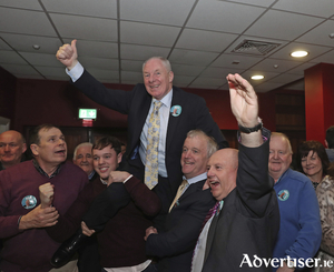 Up and in: Michael Ring celebrates after being elected. Photo: Michael Donnelly