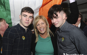 Rose blooms: Rose Conway Walsh Sinn Féin celebrates with her sons Peter and Anthony at the Mayo count at the TF Royal Theatre Castlebar. Photo: Conor McKeown