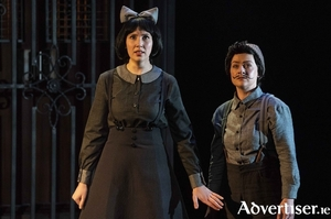 Amy Ní Fhearraigh as Gretel and Raphaela Mangan as Hansel in Irish National Opera, Theatre Lovett, and The Abbey Theatre's reinterpretation of Englebert Humperdinck's Hansel and Gretel.