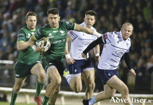 Making metres: Connacht full back Tiernan O'Halloran bursts through the Cardiff cover. Photo: Mike Shaughnessy