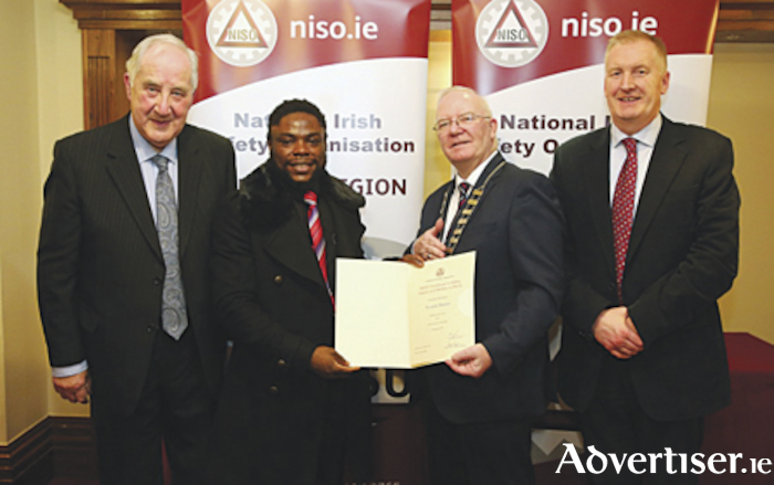 John Flanagan, Chairman NISO Midlands Branch, Yannick Maseke (Lissywollen, Athlone) receiving his certificate from Mr. Harry Galvin, President of NISO and Mr. Seadna Ryan, Head of Department of Lifelong Learning, AIT.