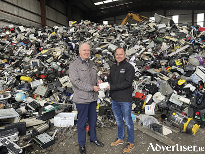Max Kyck, General Manager of KMK Metals Recycling presenting a cheque for €600 to Noel Greene, Community Fundraising Coordinator, Midlands Simon Community, following the Christmas lights recycling campaign.