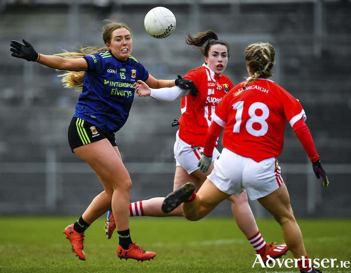 Eyes on the ball: Mary McHale of Mayo in action against Shauna Kelly on Sunday. Photo: Sportsfile