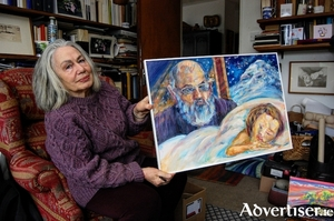 Laura Vecchi Ford with her portrait of the Italian writer Umberto Eco. Photo:- Dean Kelly