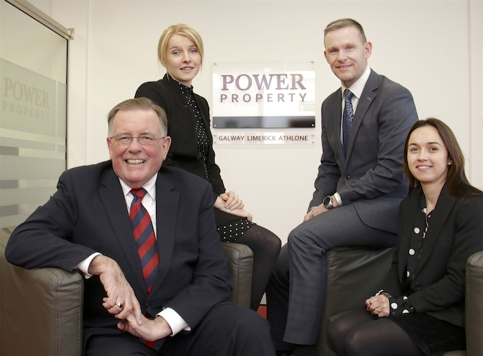 P J Power (seated) with Claire Glynn associate director, Andrew Carberry director