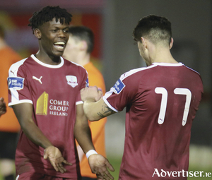 Wilson Waweru celebrates scoring Galway Uited's second goal with teammate Alberto Cabanyes in action from the League Cup tie against Athlone Town at Eamonn Deacy Park on Tuesday night. Photo:-Mike Shaughnessy