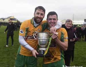 Favourites: Corofin captain Micheal Lundy and Dylan Wall will be looking to celebrate another victory after winning last season's Galway Senior Club Football Championship.   