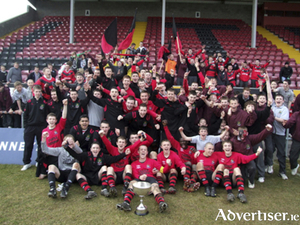 Players, coaches, and supporters from St Mary's College, Galway, celebrate winning the 2010 Umbro All Ireland secondary schools final.